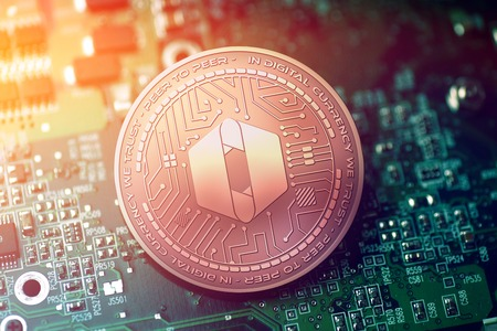 shiny copper SOLA cryptocurrency coin on blurry motherboard background