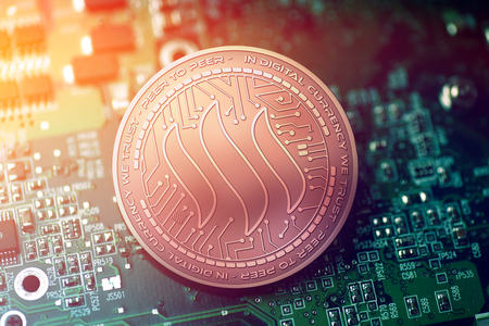 shiny copper STEEM cryptocurrency coin on blurry motherboard background Stock Photo