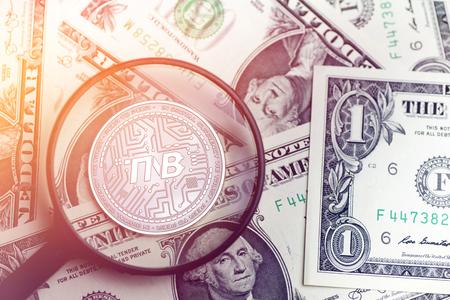 shiny golden TNB cryptocurrency coin on blurry background with dollar money 3d illustration Reklamní fotografie
