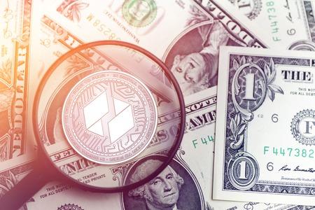 shiny golden UBIQ cryptocurrency coin on blurry background with dollar money 3d illustration Reklamní fotografie