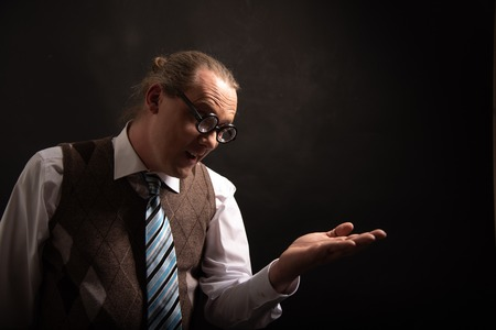 Funny nerd or geek looking to empty hand