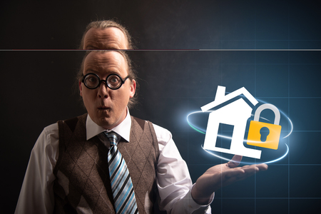 Funny nerd or geek looking to camera with home insurance icon having an idea