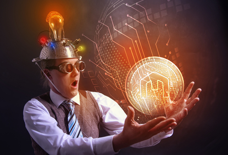 distraught looking conspiracy believer in suit with aluminum foil head with MCAP cryotocurrency coin 스톡 콘텐츠