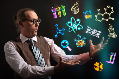 Funny scientist looking to chemistry symbols chemical
