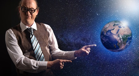 Funny scientist looking to universe and planet earth Imagens