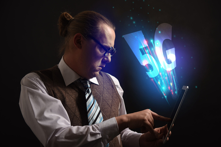 Funny nerd or geek wiith tablet and 5G symbol