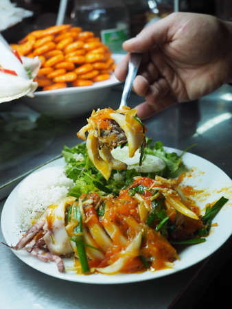 Street food in Hoi An. Stuffed squid on white plate. Vietnam, March 2017. Stock Photo