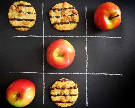 Cookies vs. apples in Tic Tac Toe game. Sugar vs. vitamins. Sugar vs. fruit.