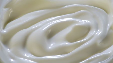 waved: Milky cream waved surface. Close-up.