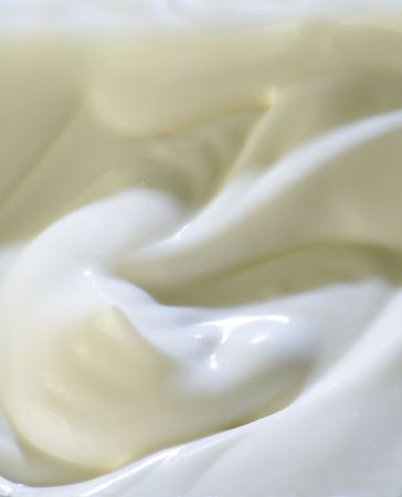 Milky cream waved surface. Close-up.