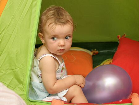 A girl in a green tent.