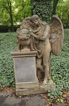 memento: A sculpture of the mourning angel. Old graveyard.