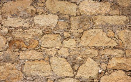 foundation cracks: An old wall. Stonework texture.