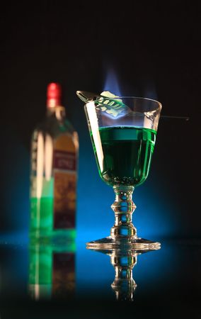 A glass of absinth with burning sugar upon. Stock Photo - 1979296