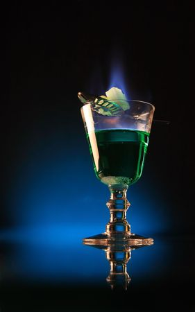 A glass of absinth with burning sugar upon. photo