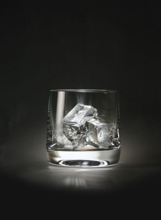 A glass with ice cubes