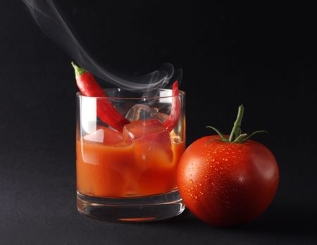 An icy hot cocktail with tomato juice, vodka and chili pepper. photo