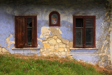 guard house: A blue wall of an old house. A seraph as the house guard.