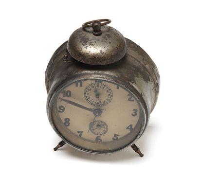alarmclock: An old rusty alarm-clock with its handmade face.