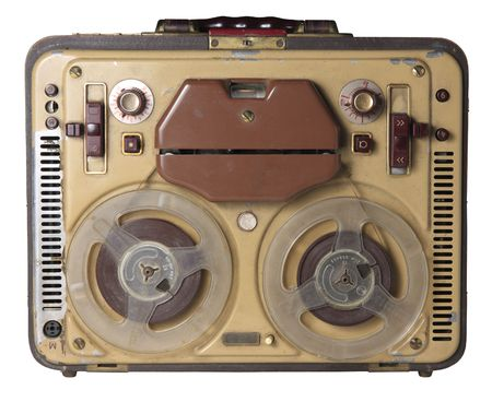 An old portable tape-recorder. Isolated.