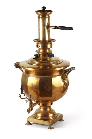 An old shiny samovar. The traditional Russian kitchen utensil. photo