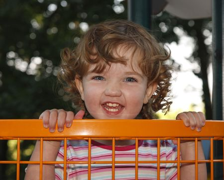 The child is having fun on the playground. photo