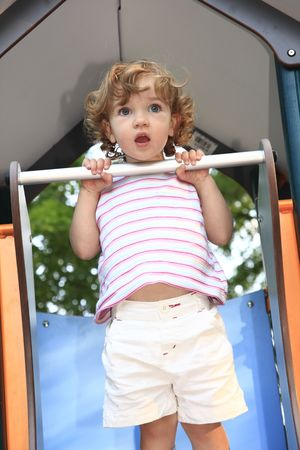 The child is perplexed by situation on the playground. photo
