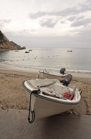 fishermens: Two fishermens boats on the beach. Morning seascape.