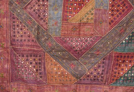 Turkish patchwork blanket decorated with simple ornaments. photo