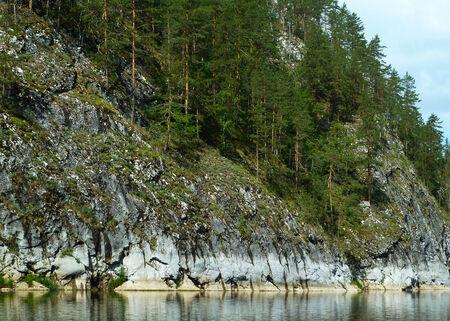steep mountain near river Stock Photo