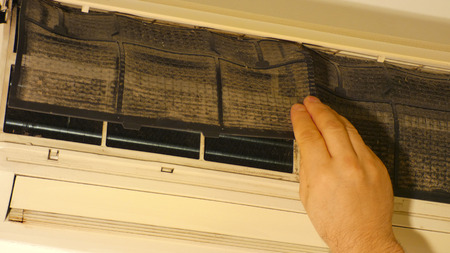 cleaning the air conditioner. dirty filter.