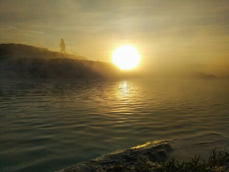 man climbs a hill at sunrise. Conceptual design.