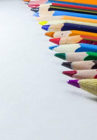 Art and drawing creative concepts of colorful crayon pencils with triangle shape on white background with copy space. Top view, Close-up, For banner design. 版權商用圖片