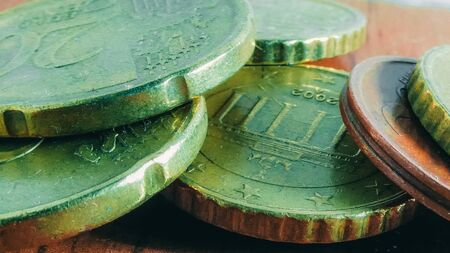 Euro coins super close-up. Shallow DOF. Part euro coin on metallic background.