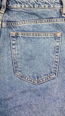 Blue jean back pocket design, texture , backdrop ,wallpaper and background.