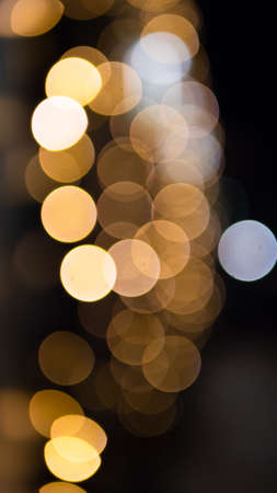 Christmas golden background. Golden holiday glowing background. Defocused background with a twinkling star, Blurred bokeh curtain