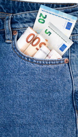 Euro currency, money in jeans pocket ready for travel and shopping. Banco de Imagens