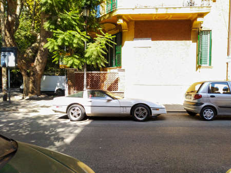 old sports car parked on the streets of Rome Italy.