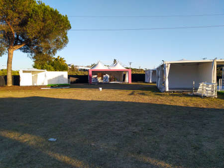 workers set up tents to prepare for the fair