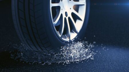 3d rendered illustration of a car tire with water splash. Depth of field blur on black background. Selective focus. DOF blur effect