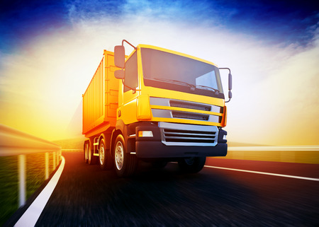 moving truck: 3d rendered illustration of a orange semi-truck on blurry asphalt road under blue sky and sunset light Stock Photo