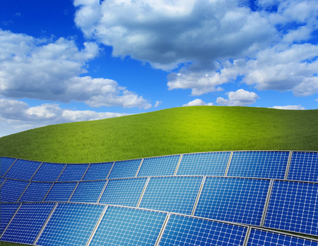 3d rendered illustration with green grass field and stack of solar panels Stock Photo