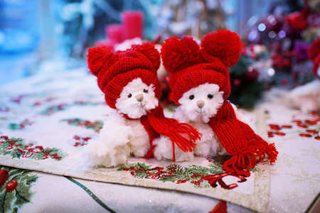 two toy - plush dogs in knitted hats on New Years background Stock Photo