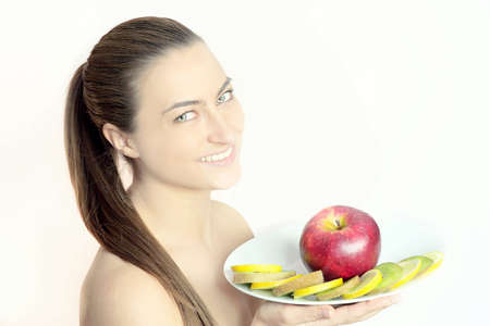 Young natural woman with a plate of fruits photo
