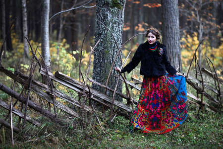 Magnificent charming gipsy woman staying outdoor  photo
