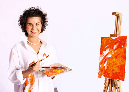 Young smiling curly woman painter  photo