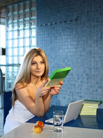 adult natural woman sitting in spa with a facial mask Stock Photo - 19456668