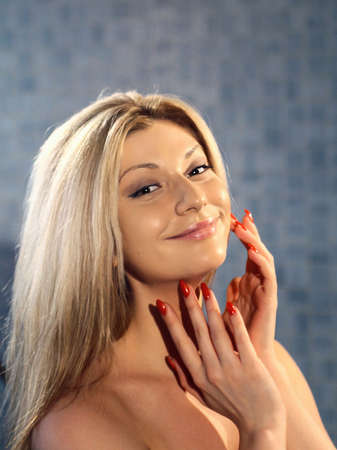 happy naturally looks young blonde woman in spa photo