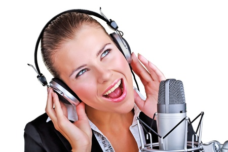 Singing woman in front of a microphone headset on white background Stock Photo