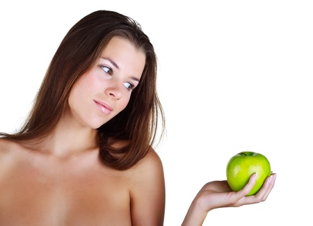 Beautiful girl holds in a hand green apple, isolated on white background Stock Photo - 10747701